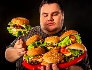 fat man with platter of burger