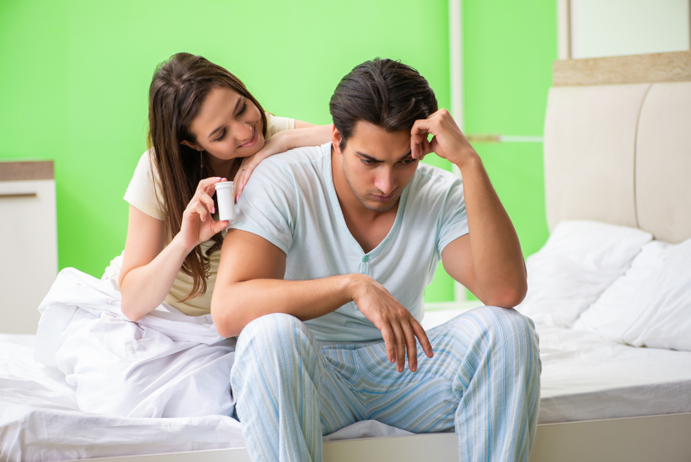 woman recommending sex enhancement supplement to husband