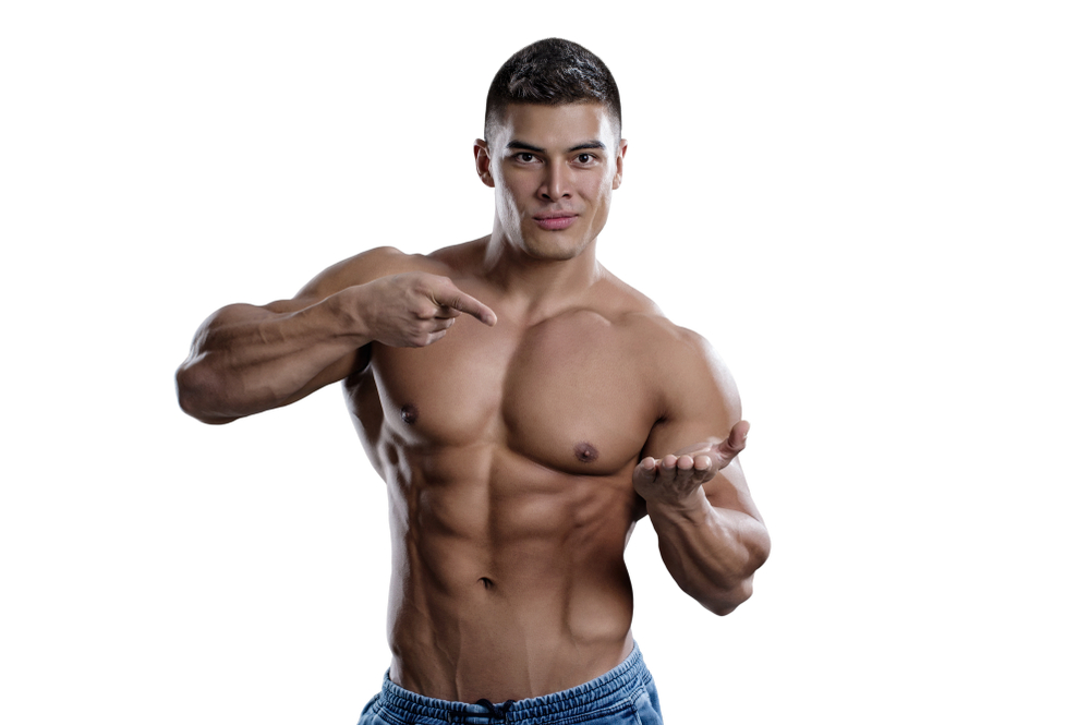 man pointing at supplement pills