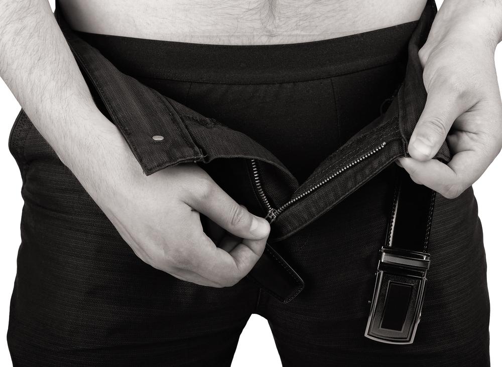 opening his jean zipper