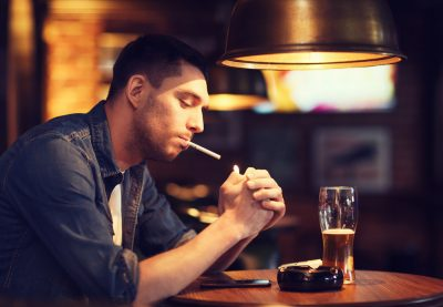 smoking and drinking in a pub