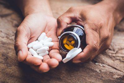man taking supplement pills