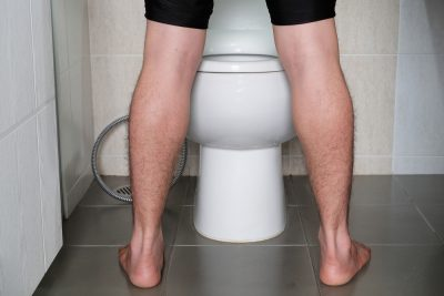 man peeing in toilet
